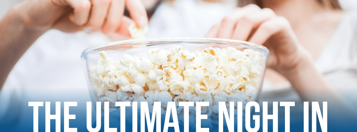 Couple eating popcorn during the ultimate night in